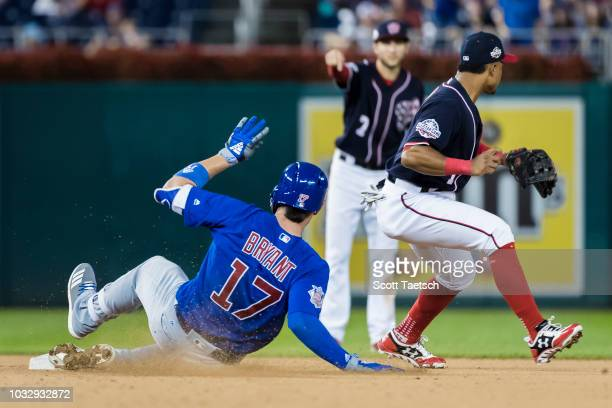 Kris Bryant of the Chicago Cubs doubles against the Washington Nationals during the tenth inning at Nationals Park on September 13 2018 in Washington...