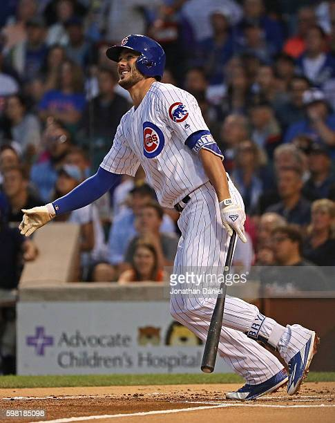 Kris Bryant of the Chicago Cubs follows the flight of his 36th home run of the season a solo shot in the 1st inning against the Pittsburgh Pirates at...