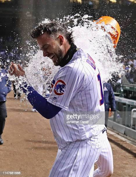 Kris Bryant of the Chicago Cubs gets dunked by Javier Baez after he hit the gamewinning three run home run in the bottom of the 9th inning against...
