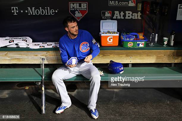 Kris Bryant of the Chicago Cubs gets ready in the dugout before the start of Game 2 of the 2016 World Series against the Cleveland Indians at...