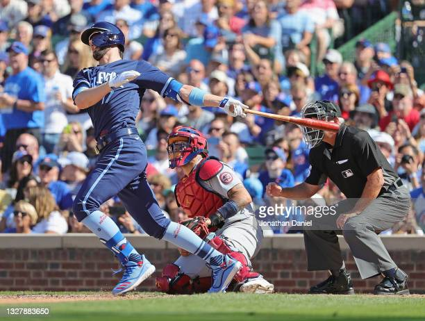 Kris Bryant of the Chicago Cubs hits a pinch hit, three run double in the 7th inning against the St. Louis Cardinals at Wrigley Field on July 09,...
