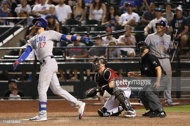 Kris Bryant of the Chicago Cubs hits a sacrifice fly against the Arizona Diamondbacks during the 15th inning of the MLB game at Chase Field on April...