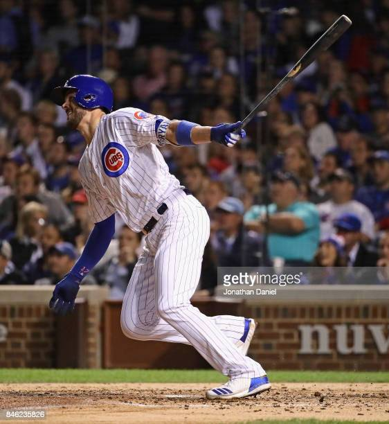 Kris Bryant of the Chicago Cubs hits a three run home run in the 4th inning against the New York Mets at Wrigley Field on September 12 2017 in...