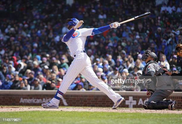 Kris Bryant of the Chicago Cubs hits a two run double during the second inning of a game against the Arizona Diamondbacks at Wrigley Field on April...
