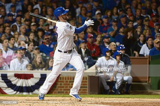 Kris Bryant of the Chicago Cubs hits a tworun home run in the fifth inning against the St Louis Cardinals during game three of the National League...