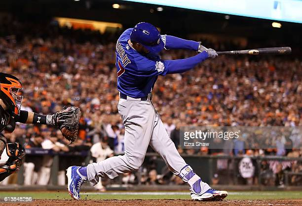 Kris Bryant of the Chicago Cubs hits a tworun home run in the ninth inning against the San Francisco Giants during Game Three of their National...