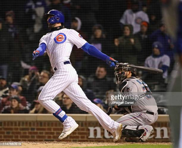 Kris Bryant of the Chicago Cubs hits the gamewinning three run home run in the bottom of the 9th inning against the Miami Marlins at Wrigley Field on...