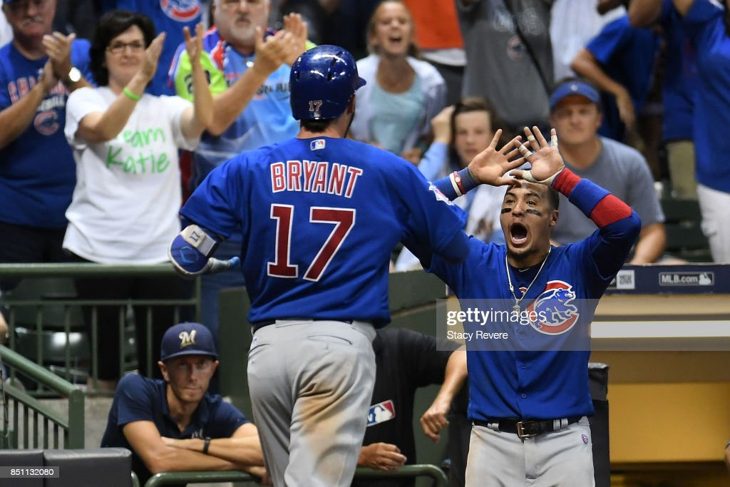Kris Bryant #17 of the Chicago Cubs is congratulated by Javier Baez #9 following a two run home run against the Milwaukee Brewers during the tenth inning of a game at Miller Park on September 21, 2017 in Milwaukee, Wisconsin.