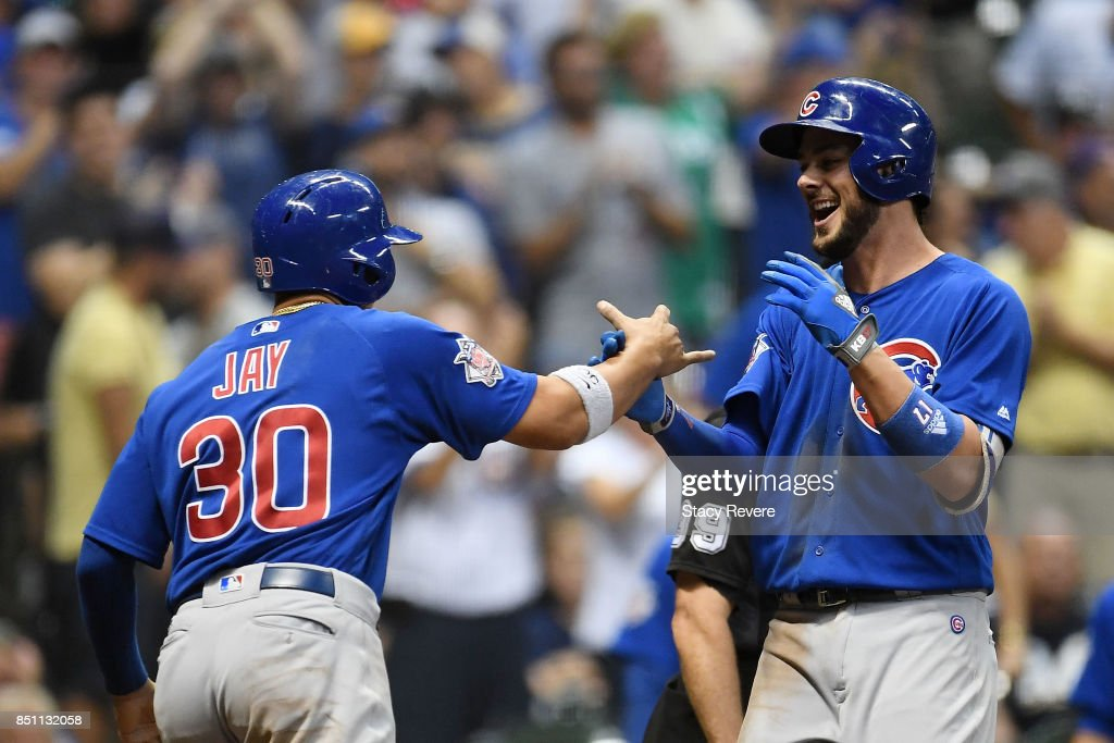 Kris Bryant #17 of the Chicago Cubs is congratulated by Jon Jay #30 following a two run home run against the Milwaukee Brewers during the tenth inning of a game at Miller Park on September 21, 2017 in Milwaukee, Wisconsin.