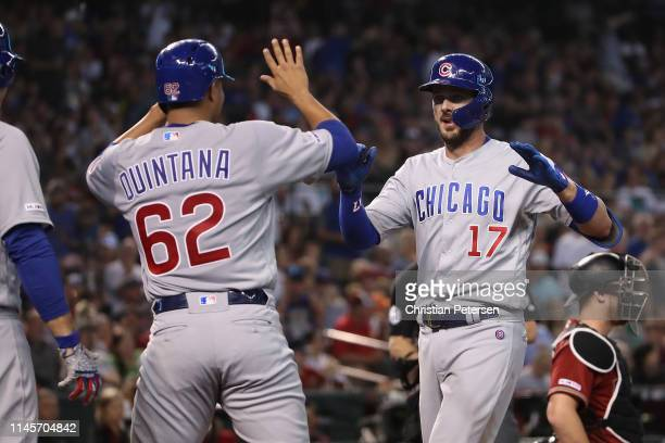Kris Bryant of the Chicago Cubs is congratulated by Jose Quintana after hitting a two-run home run against the Arizona Diamondbacks during the third...