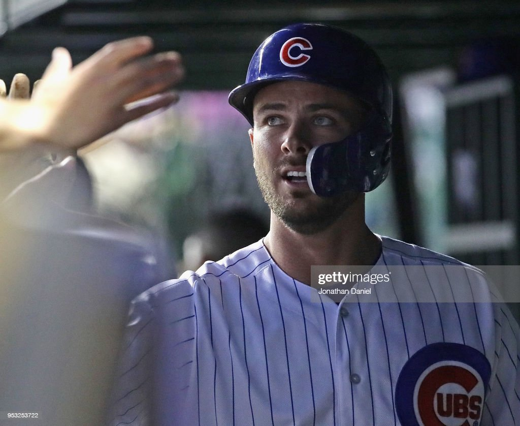 Kris Bryant #17 of the Chicago Cubs is congratulated by teammates in the dugout after scoring the game-winning run in the 7th inning against the Colorado Rockies at Wrigley Field on April 30, 2018 in Chicago, Illinois. The Cubs defeated the Rockies 3-2.