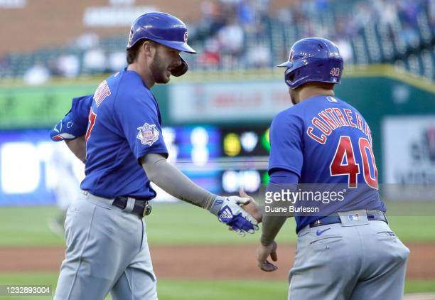 Kris Bryant of the Chicago Cubs is congratulated by Willson Contreras after hitting a two-run home run against the Detroit Tigers during the third...