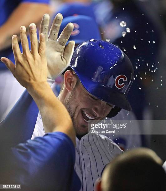 Kris Bryant of the Chicago Cubs is doused with water as he celebrates with teammates in the dugot after hitting a solo home run in the 5th innning...