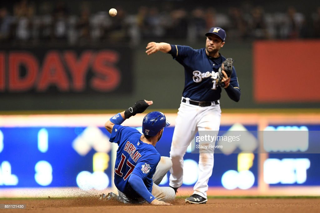 Kris Bryant #17 of the Chicago Cubs is forced out at second base as Neil Walker #15 of the Milwaukee Brewers turns a double play to end the eighth inning at Miller Park on September 21, 2017 in Milwaukee, Wisconsin.