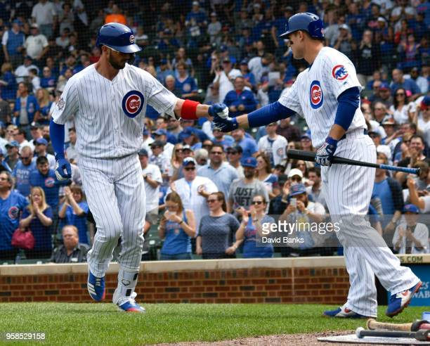 Kris Bryant of the Chicago Cubs is greeted by Anthony Rizzo of the Chicago Cubs bases after hitting a tworun homer against the Atlanta Braves during...