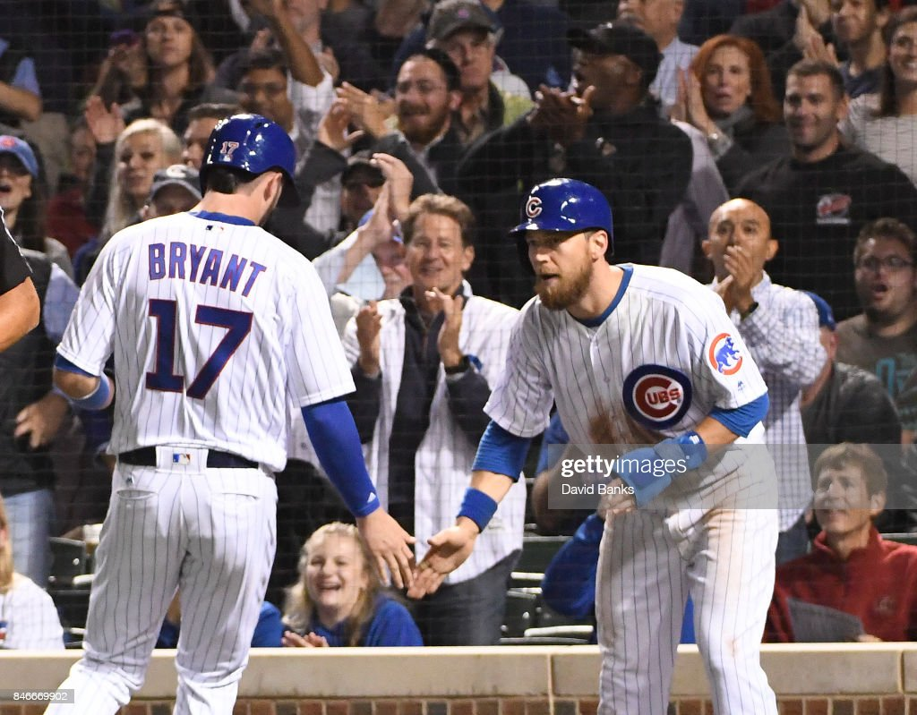 Kris Bryant #17 of the Chicago Cubs is greeted by Ben Zobrist #18 of the Chicago Cubs after they scored against the New York Mets during the fourth inning on September 13, 2017 at Wrigley Field in Chicago, Illinois.