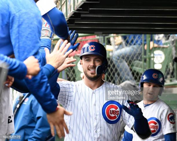 Kris Bryant of the Chicago Cubs is greeted by his teammates after hitting a home run against the St Louis Cardinals during the fourth inning on...