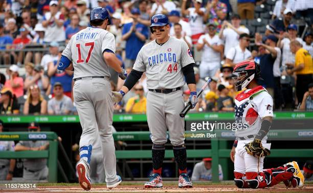 Kris Bryant of the Chicago Cubs is met at home plate by Anthony Rizzo after hitting a home run in the first inning during the game against the...