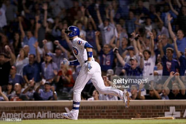Kris Bryant of the Chicago Cubs looks on after hitting a home run in the eighth inning against the San Francisco Giants at Wrigley Field on August 21...