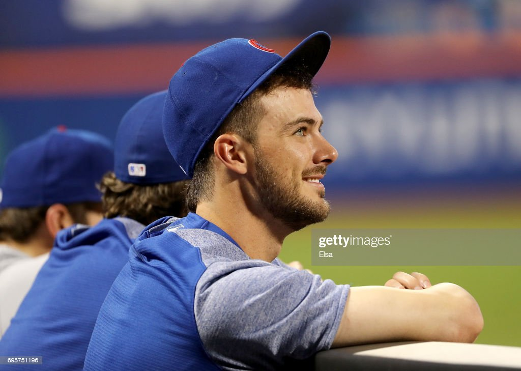 Kris Bryant #17 of the Chicago Cubs looks on from the dugout in the ninth inning against the New York Mets on June 13, 2017 at Citi Field in the Flushing neighborhood of the Queens borough of New York City.