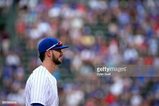 Kris Bryant of the Chicago Cubs plays third base in the ninth inning against the Cincinnati Reds at Wrigley Field on August 17 2017 in Chicago...