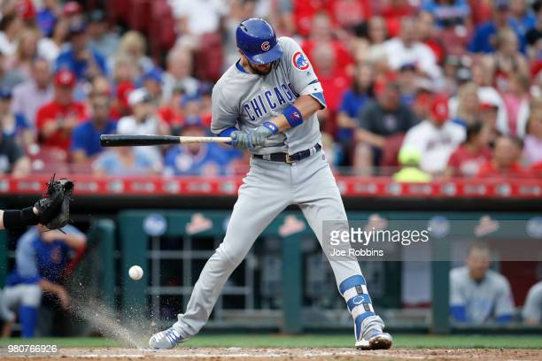 Kris Bryant of the Chicago Cubs reacts after being hit by a pitch to lead off the third inning against the Cincinnati Reds at Great American Ball...