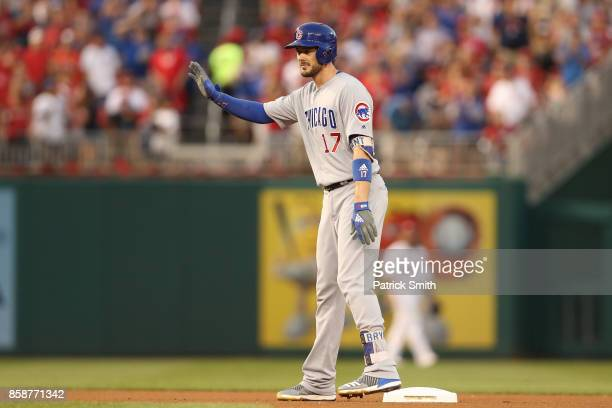 Kris Bryant of the Chicago Cubs reacts after hitting a double against the Washington Nationals in the fourth inning during game two of the National...