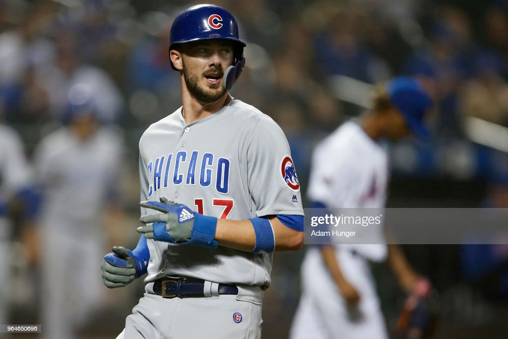 Kris Bryant #17 of the Chicago Cubs reacts after scoring a run in front of Gerson Bautista #46 of the New York Mets during the ninth inning at Citi Field on May 31, 2018 in the Flushing neighborhood of the Queens borough of New York City. The Cubs defeated the Mets 5-1.