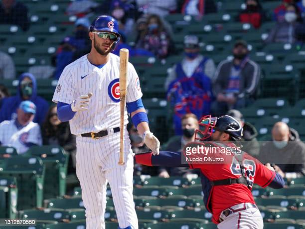 Kris Bryant of the Chicago Cubs reacts after striking out during the fifth inning of a game against the Atlanta Braves at Wrigley Field on April 16,...