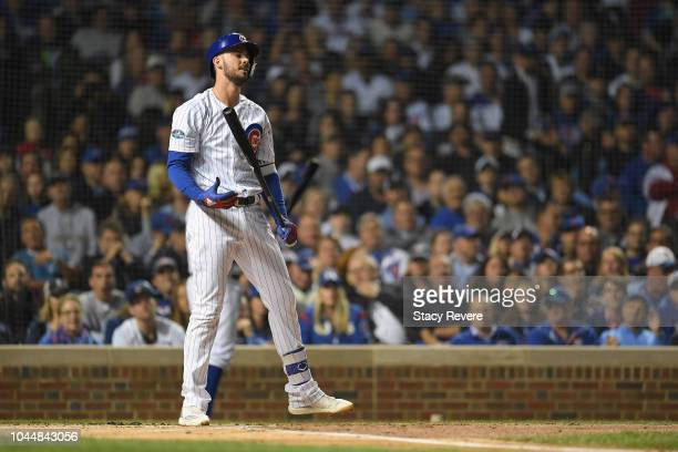 Kris Bryant of the Chicago Cubs reacts after striking out in the first inning against the Colorado Rockies during the National League Wild Card Game...