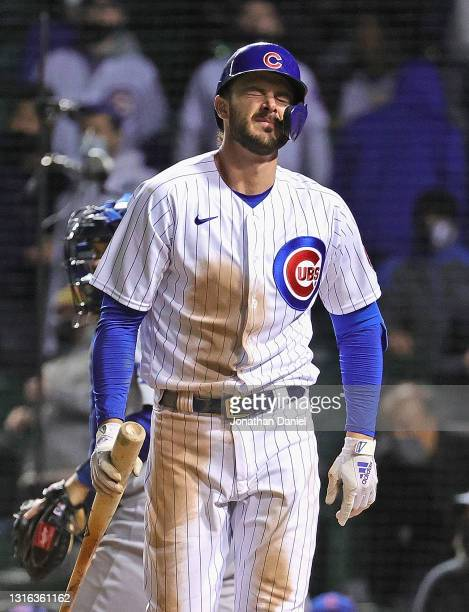 Kris Bryant of the Chicago Cubs reacts after striking out with the bases loaded to end the 4th inning against the Los Angeles Dodgers at Wrigley...