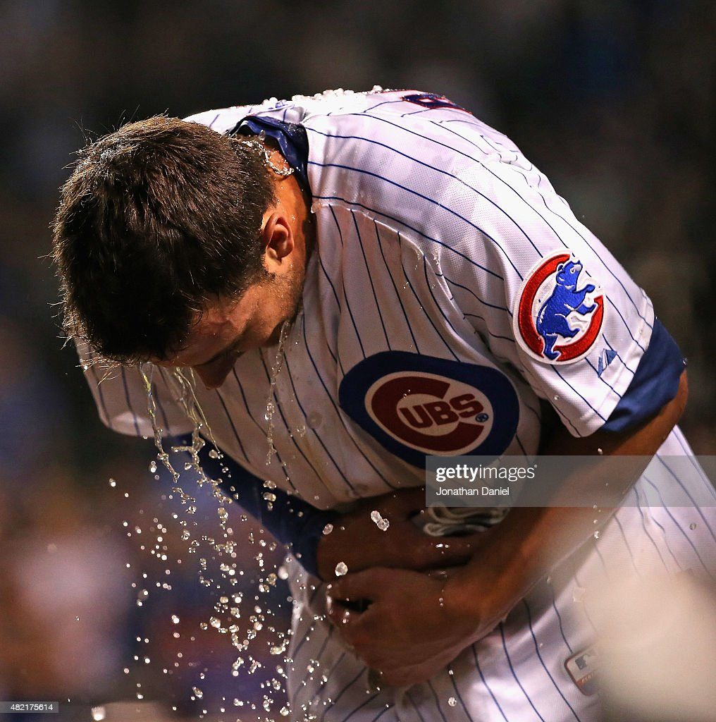 Kris Bryant #17 of the Chicago Cubs recovers from a Gatorade shower from teammate Anthony Rizzo after he hit a game-winning, two-run home run in the bottom of the 9th inning against the Colorado Rockies at Wrigley Field on July 27, 2015 in Chicago, Illinois. The Cubs defeated the Rockies 9-8.