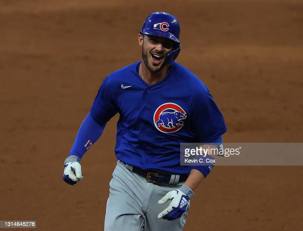 Kris Bryant of the Chicago Cubs rounds second base after hitting a grand slam in the third inning against the Atlanta Braves at Truist Park on April...