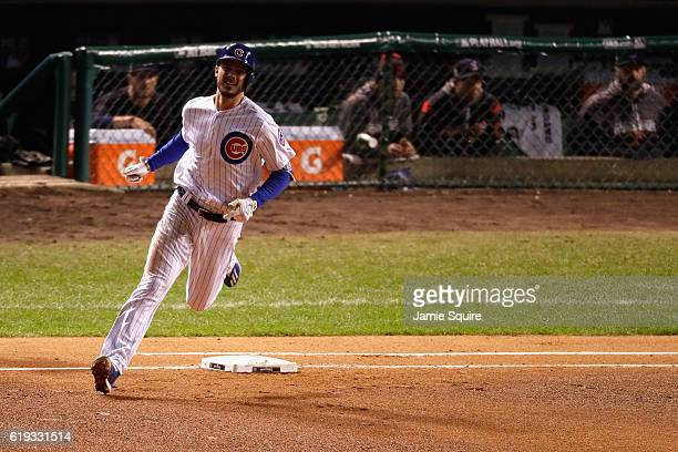 Kris Bryant of the Chicago Cubs rounds the bases after hitting a home run in the fourth inning against the Cleveland Indians in Game Five of the 2016...