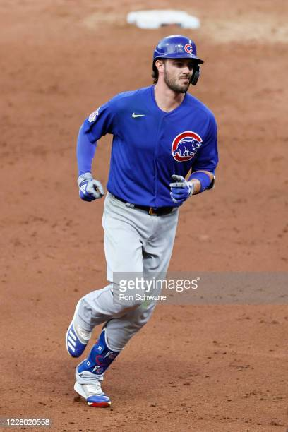 Kris Bryant of the Chicago Cubs rounds the bases after hitting a solo home run off relief pitcher Adam Cimber of the Cleveland Indians during the...