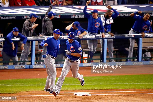 Kris Bryant of the Chicago Cubs rounds the bases after hitting a solo home run during the first inning against Josh Tomlin of the Cleveland Indians...