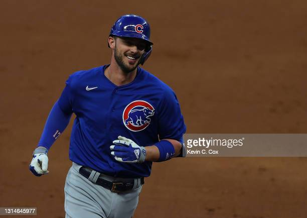 Kris Bryant of the Chicago Cubs rounds third base after hitting a grand slam in the third inning against the Atlanta Braves at Truist Park on April...