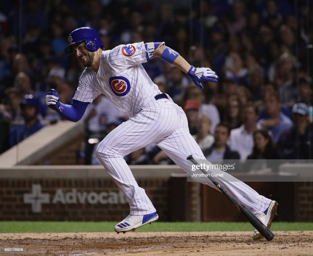 Kris Bryant #17 of the Chicago Cubs runs after batting against the New York Mets at Wrigley Field on September 12, 2017 in Chicago, Illinois. The Cubs defeated the Mets 8-3.