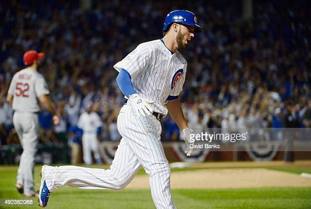 Kris Bryant of the Chicago Cubs runs the bases after hitting a tworun home run in the fifth inning against the St Louis Cardinals during game three...