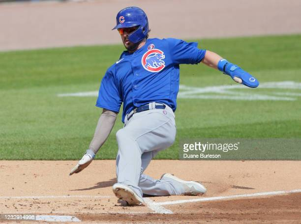 Kris Bryant of the Chicago Cubs scores against the Detroit Tigers on a double by Anthony Rizzo during the first inning at Comerica Park on May 15 in...