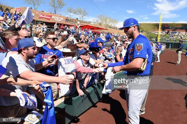 Kris Bryant of the Chicago Cubs signs autographs prior to a spring training game against the Colorado Rockies at Salt River Fields at Talking Stick...