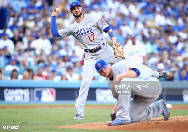 Kris Bryant of the Chicago Cubs throws the ball to Anthony Rizzo after a bunt by Cody Bellinger of the Los Angeles Dodgers during Game Two of the...