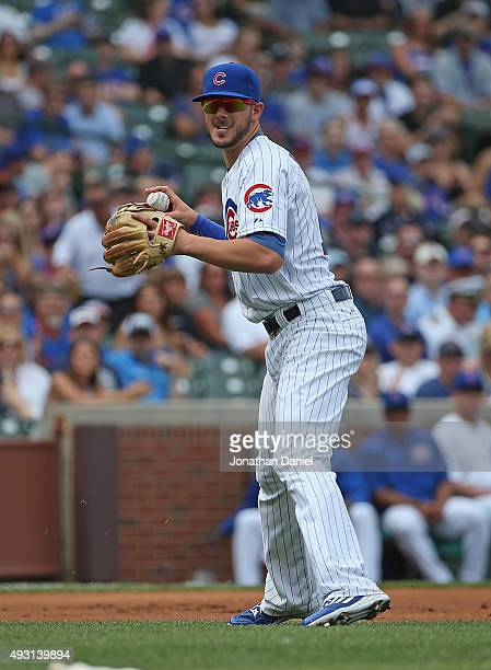 Kris Bryant of the Chicago Cubs throws to first base against the San Francisco Giants at Wrigley Field on August 7, 2015 in Chicago, Illinois.