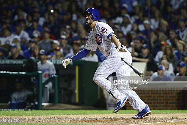 Kris Bryant of the Chicago Cubs tosses his bat after hitting an RBI double to score Dexter Fowler in the first inning against the Los Angeles Dodgers...