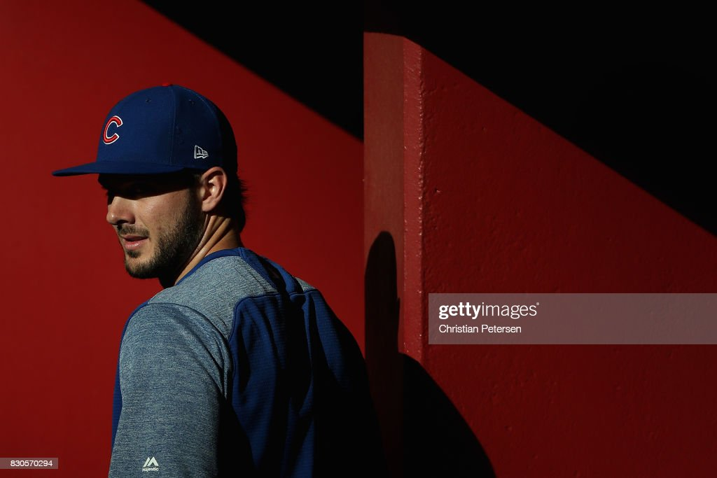 Kris Bryant #17 of the Chicago Cubs walks in the dugout before the MLB game against the Arizona Diamondbacks at Chase Field on August 11, 2017 in Phoenix, Arizona.