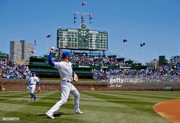 Kris Bryant of the Chicago Cubs warms up before the game against the Milwaukee Brewers in his first start since being hit by a pitch severeal days...