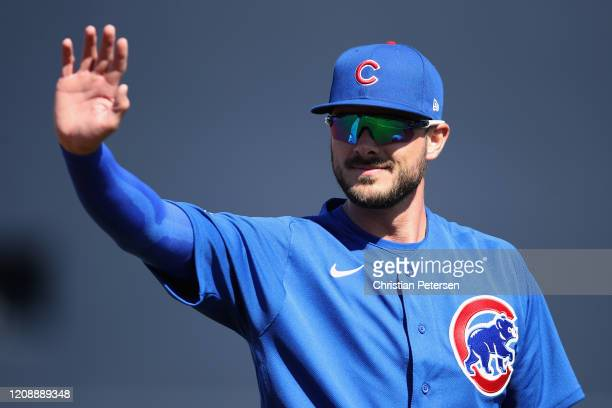 Kris Bryant of the Chicago Cubs waves to fans during the MLB spring training game against the Seattle Mariners at Peoria Stadium on February 24, 2020...