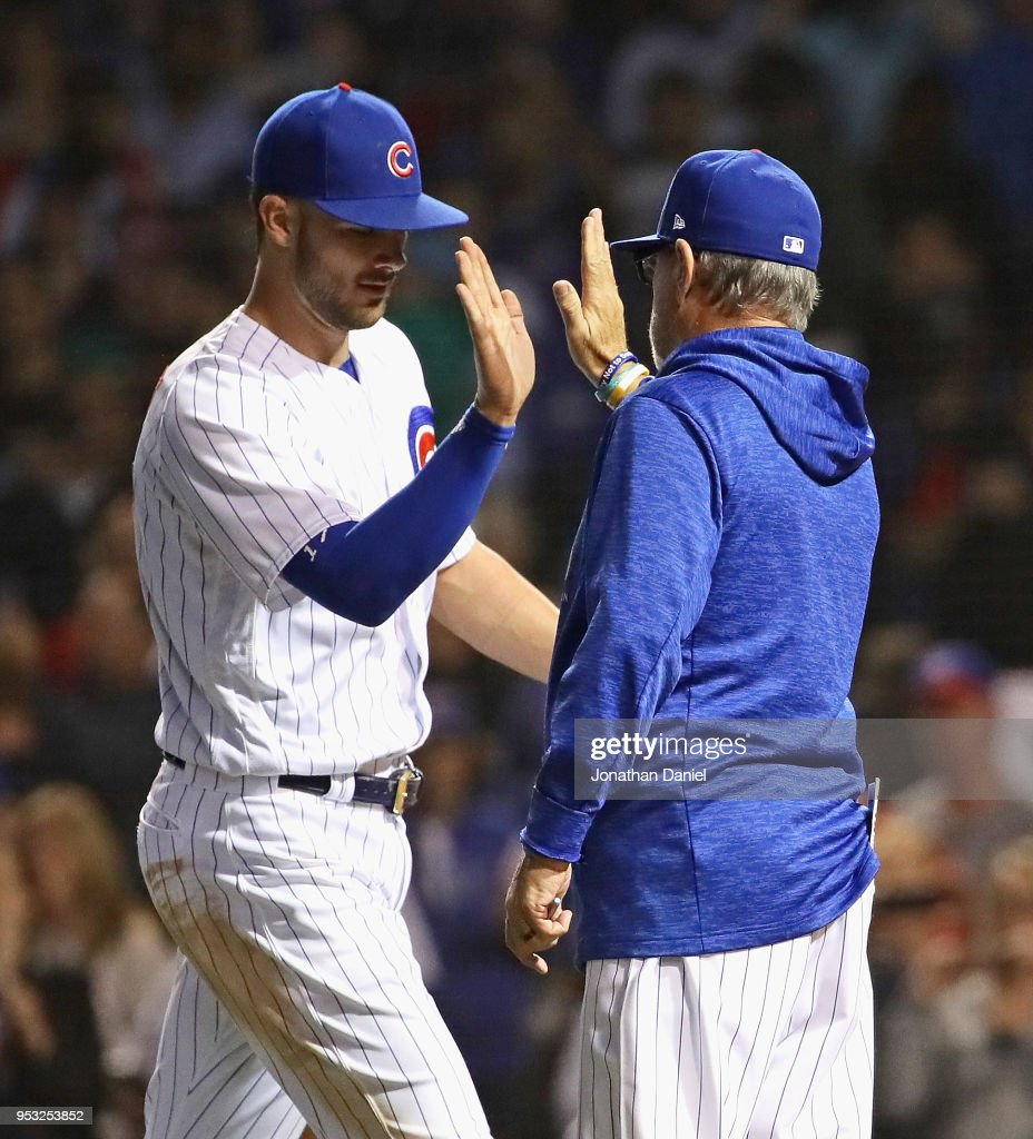 Kris Bryant #17 of the Chicago Cubsis congratulated by manager Joe Maddon #70 after a win over the Colorado Rockies at Wrigley Field on April 30, 2018 in Chicago, Illinois. The Cubs defeated the Rockies 3-2.