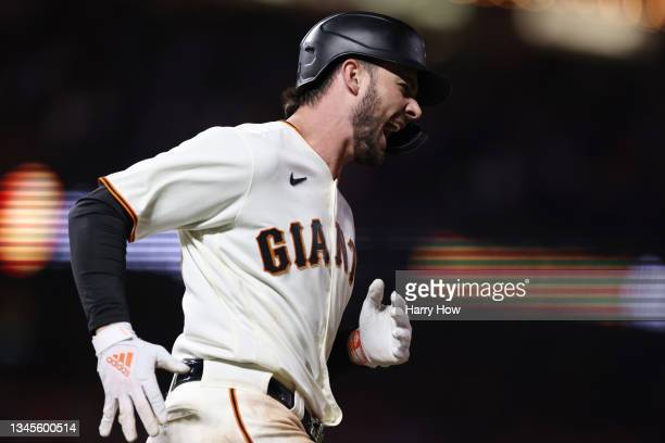 Kris Bryant of the San Francisco Giants celebrates after hitting a solo home run off Walker Buehler of the Los Angeles Dodgers during the seventh...