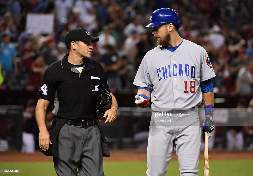 Kris Bryant #17 the Chicago Cubs has a few words for home plate umpire Mark Wegner #14 after a third called strike to the end the game against the Arizona Diamondbacks at Chase Field on August 12, 2017 in Phoenix, Arizona. Diamondbacks won 6-2.